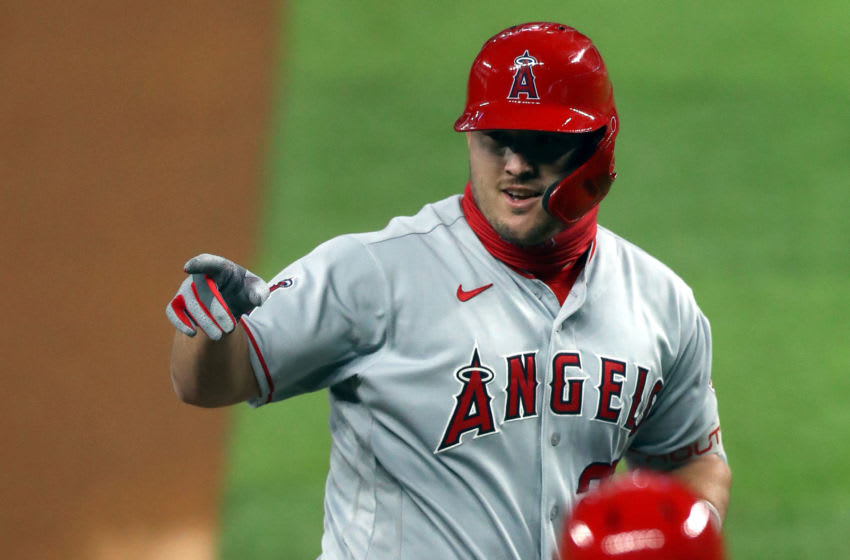 ARLINGTON, TEXAS - AUGUST 07: Mike Trout #27 of the Los Angeles Angels runs the bases after hitting a two-run home run in the first inning against the Texas Rangers at Globe Life Field on August 07, 2020 in Arlington, Texas. (Photo by Ronald Martinez/Getty Images)