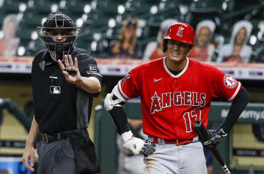 HOUSTON, TEXAS - AUGUST 25: Home plate umpire Clint Vondrak motions to manager Joe Maddon #70 of the Los Angeles Angels who was complaining after Shohei Ohtani #17 was called oput on strikes during game two of a doubleheader at Minute Maid Park on August 25, 2020 in Houston, Texas. Maddon was ejected from the game. (Photo by Bob Levey/Getty Images)