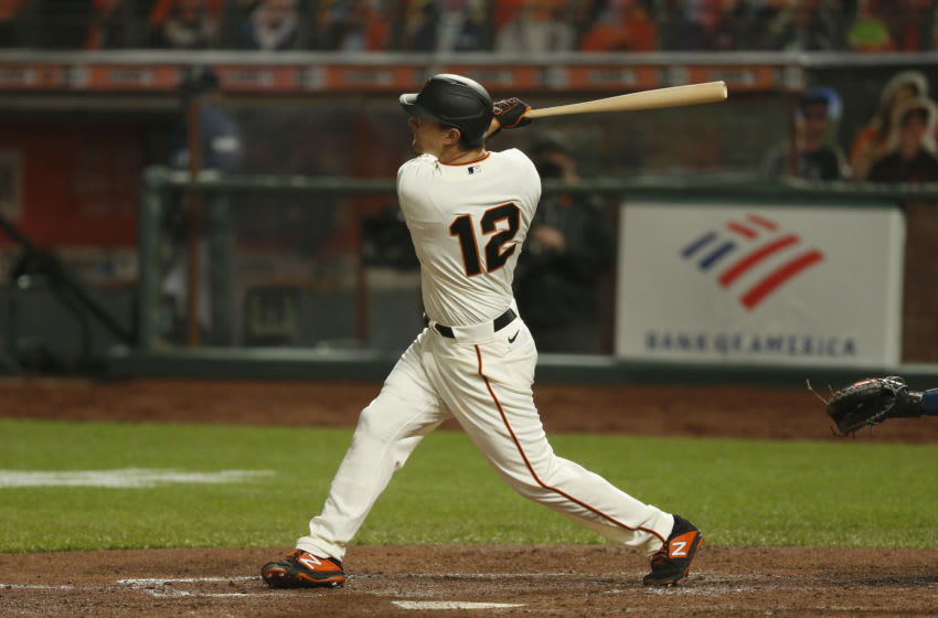 SAN FRANCISCO, CALIFORNIA - SEPTEMBER 08: Alex Dickerson #12 of the San Francisco Giants hits a solo home run in the bottom of the third inning against the Seattle Mariners at Oracle Park on September 08, 2020 in San Francisco, California. (Photo by Lachlan Cunningham/Getty Images)