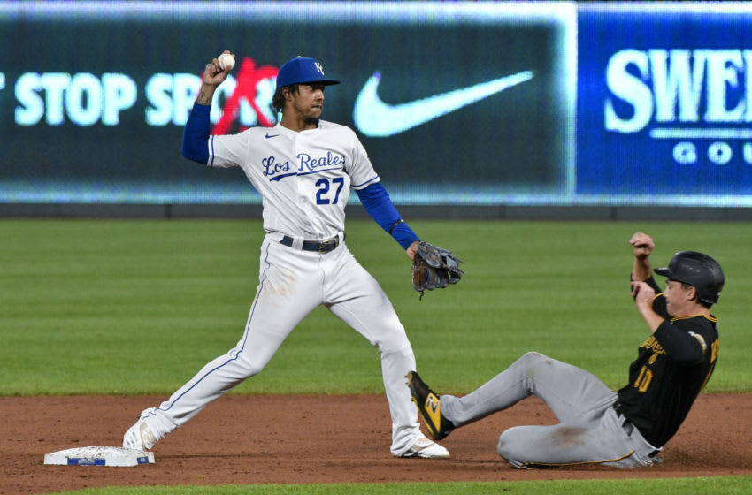 KANSAS CITY, MISSOURI - SEPTEMBER 12: Shortstop Adalberto Mondesi #27 of the Kansas City Royals throws past Bryan Reynolds #10 of the Pittsburgh Pirates to first to complete a double play in the fifth inning at Kauffman Stadium on September 12, 2020 in Kansas City, Missouri. (Photo by Ed Zurga/Getty Images)