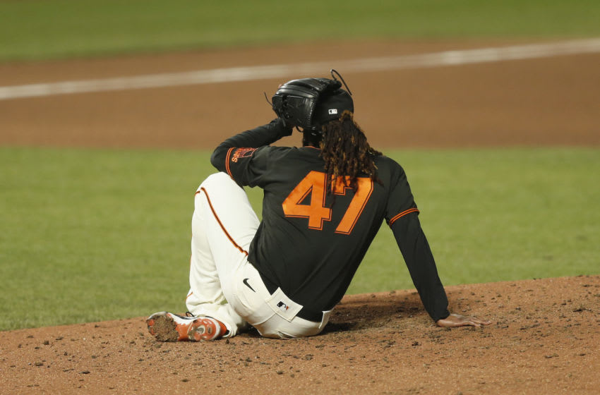 SAN FRANCISCO, CALIFORNIA - SEPTEMBER 26: Pitcher Johnny Cueto #47 of the San Francisco Giants sits on the the pitching mound after being hit being throw from catcher Tyler Heineman #43 in the top of the sixth inning against the San Diego Padres at Oracle Park on September 26, 2020 in San Francisco, California. (Photo by Lachlan Cunningham/Getty Images)
