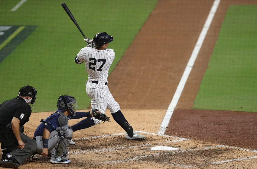 SAN DIEGO, CALIFORNIA - OCTOBER 07: Giancarlo Stanton #27 of the New York Yankees hits a two run home run against the Tampa Bay Rays during the eighth inning in Game Three of the American League Division Series at PETCO Park on October 07, 2020 in San Diego, California. (Photo by Sean M. Haffey/Getty Images)