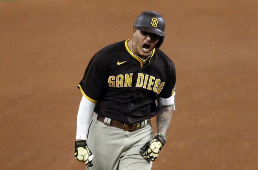 ARLINGTON, TEXAS - OCTOBER 07: Manny Machado #13 of the San Diego Padres reacts as he runs the bases after hitting a solo home run during the sixth inning against the Los Angeles Dodgers in Game Two of the National League Division Series at Globe Life Field on October 07, 2020 in Arlington, Texas. (Photo by Ronald Martinez/Getty Images)