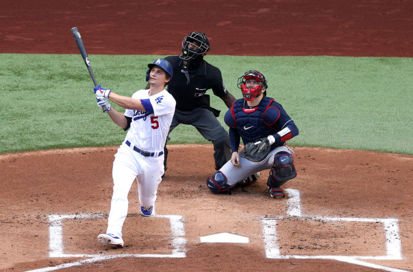 ARLINGTON, TEXAS - OCTOBER 17: Corey Seager #5 of the Los Angeles Dodgers hits a solo home run against the Atlanta Braves during the first inning in Game Six of the National League Championship Series at Globe Life Field on October 17, 2020 in Arlington, Texas. (Photo by Rob Carr/Getty Images)