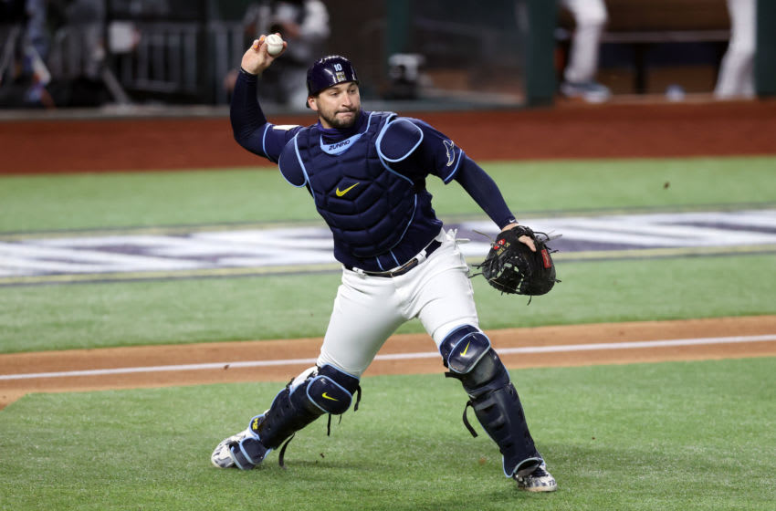 ARLINGTON, TEXAS - OCTOBER 24: Mike Zunino #10 of the Tampa Bay Rays throws out the runner against the Los Angeles Dodgers during the second inning in Game Four of the 2020 MLB World Series at Globe Life Field on October 24, 2020 in Arlington, Texas. (Photo by Tom Pennington/Getty Images)