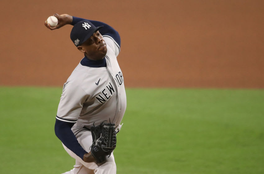 SAN DIEGO, CALIFORNIA - OCTOBER 09: Relief pitcher Aroldis Chapman #54 of the New York Yankees pitches against the Tampa Bay Rays in Game Five of the American League Division Series at PETCO Park on October 09, 2020 in San Diego, California. (Photo by Christian Petersen/Getty Images)