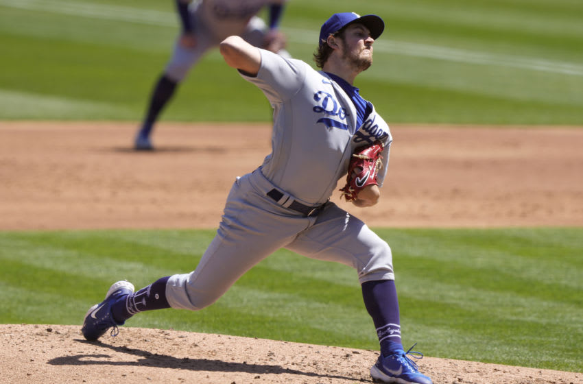 OAKLAND, CALIFORNIA - APRIL 07: Trevor Bauer #27 of the Los Angeles Dodgers pitches against the Oakland Athletics in the second inning at RingCentral Coliseum on April 07, 2021 in Oakland, California. (Photo by Thearon W. Henderson/Getty Images)