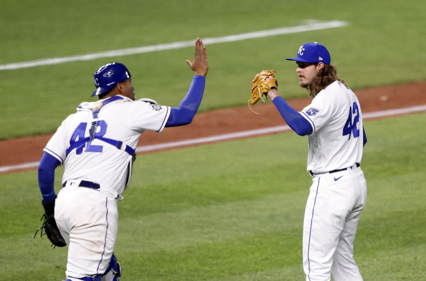 KANSAS CITY, MISSOURI - APRIL 15: Catcher Salvador Perez #13 and pitcher Scott Barlow of the Kansas City Royals celebrate after the Royals defeated the Toronto Blue Jays7-5 to win the game at Kauffman Stadium on April 15, 2021 in Kansas City, Missouri. All players are wearing the number 42 in honor of Jackie Robinson Day. (Photo by Jamie Squire/Getty Images)