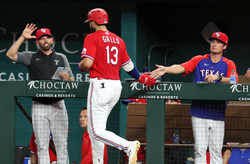 ARLINGTON, TEXAS - JUNE 04: Joey Gallo #13 of the Texas Rangers is greeted at the dugout after a solo home run in the fifth inning against the Tampa Bay Rays at Globe Life Field on June 04, 2021 in Arlington, Texas. (Photo by Richard Rodriguez/Getty Images)