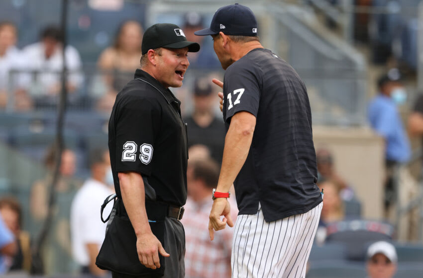 NEW YORK, NY - JUNE 19: Manager Aaron Boone #17 of the New York Yankees argues after being ejected by home plate umpire Sean Barber #29 during ninth inning of a game at Yankee Stadium on June 19, 2021 in New York City. The Yankees defeated the A