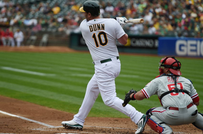 OAKLAND, CA - SEPTEMBER 21: Adam Dunn #10 of the Oakland Athletics hits an rbi single scoring Coco Crisp #4 against the Philadelphia Phillies in the bottom of the first inning at O.co Coliseum on September 21, 2014 in Oakland, California. (Photo by Thearon W. Henderson/Getty Images)