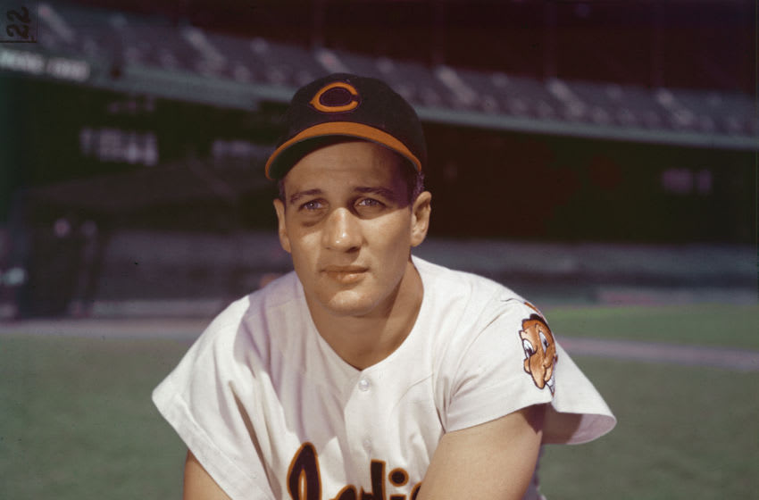Portrait of American professional baseball player Al Rosen, third baseman for the Cleveland Indians, kneeling in an empty stadium, 1950s. (Photo by Hulton Archive/Getty Images)