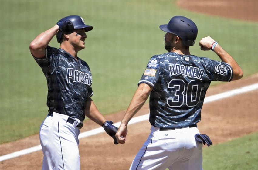 SAN DIEGO, CA - AUGUST 19: Hunter Renfroe #10 of the San Diego Padres, left, is congratulated by Eric Hosmer #30 after hitting a two-run home run during the first inning of a baseball game against the Arizona Diamondbacks at PETCO Park on August 19, 2018 in San Diego, California. (Photo by Denis Poroy/Getty Images)