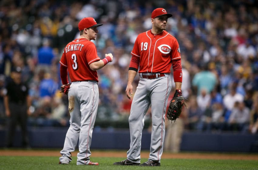 MILWAUKEE, WI - SEPTEMBER 19: Scooter Gennett #3 and Joey Votto #19 of the Cincinnati Reds meet in the sixth inning against the Milwaukee Brewers at Miller Park on September 19, 2018 in Milwaukee, Wisconsin. (Photo by Dylan Buell/Getty Images)