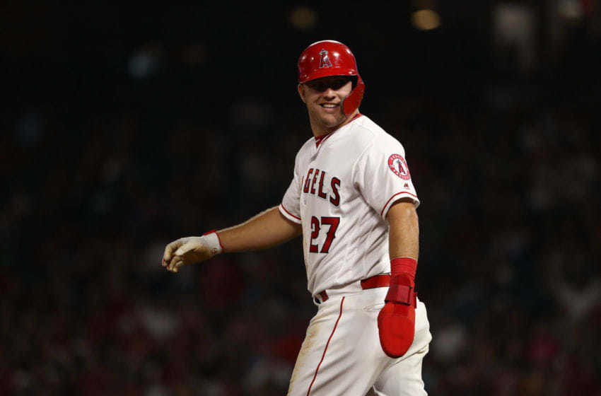 ANAHEIM, CA - SEPTEMBER 28: Mike Trout #27 of the Los Angeles Angels of Anaheim looks to the Angels dugout as Trout walks back to second base during the fifth inning of the MLB game against the Oakland Athletics at Angel Stadium on September 28, 2018 in Anaheim, California. The Angels defeated the Athletics 8-5. (Photo by Victor Decolongon/Getty Images)