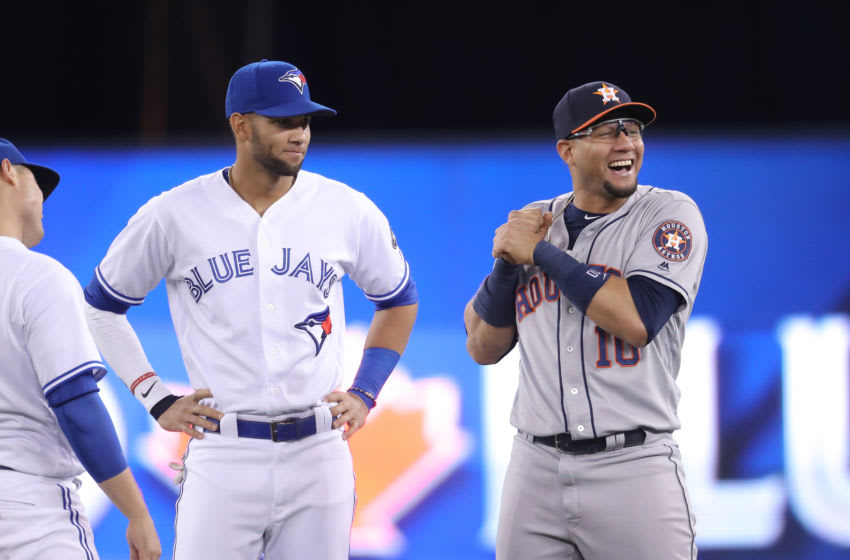 TORONTO, ON - SEPTEMBER 24: Lourdes Gurriel Jr. #13 of the Toronto Blue Jays meets with brother Yuli Gurriel #10 of the Houston Astros before the start of their MLB game at Rogers Centre on September 24, 2018 in Toronto, Canada. (Photo by Tom Szczerbowski/Getty Images)
