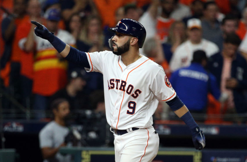 HOUSTON, TX - OCTOBER 18: Marwin Gonzalez #9 of the Houston Astros touches home plate and points to the crowd after hitting a solo home run in the seventh inning during Game 5 of the ALCS against the Boston Red Sox at Minute Maid Park on Thursday, October 18, 2018 in Houston, Texas. (Photo by Loren Elliott/MLB Photos via Getty Images)