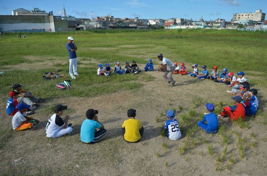 Cuban children attend a baseball class in a field of Havana, on September 17, 2018. - Football took over baseball in the preference of children and young people in Cuba, where the latter has been king for almost 150 years. (Photo by Yamil LAGE / AFP) (Photo credit should read YAMIL LAGE/AFP via Getty Images)