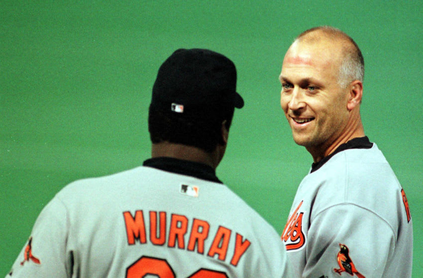 Baltimore Orioles Cal Ripken Jr. is congratulated for his 3,000th hit by coach Eddie Murray 15 April, 2000 in Minneapolis, MN. Ripken became the 24th major leaguer to hit 3000. AFPPHOTO Craig Lassig (Photo by CRAIG LASSIG / AFP) (Photo credit should read CRAIG LASSIG/AFP via Getty Images)