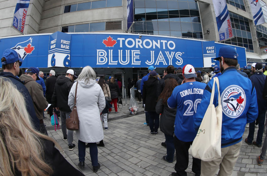 TORONTO, ON - MARCH 28: Fans gather outside the Rogers Centre on Opening Day before the Toronto Blue Jays MLB game against the Detroit Tigers at Rogers Centre on March 28, 2019 in Toronto, Canada. (Photo by Tom Szczerbowski/Getty Images)