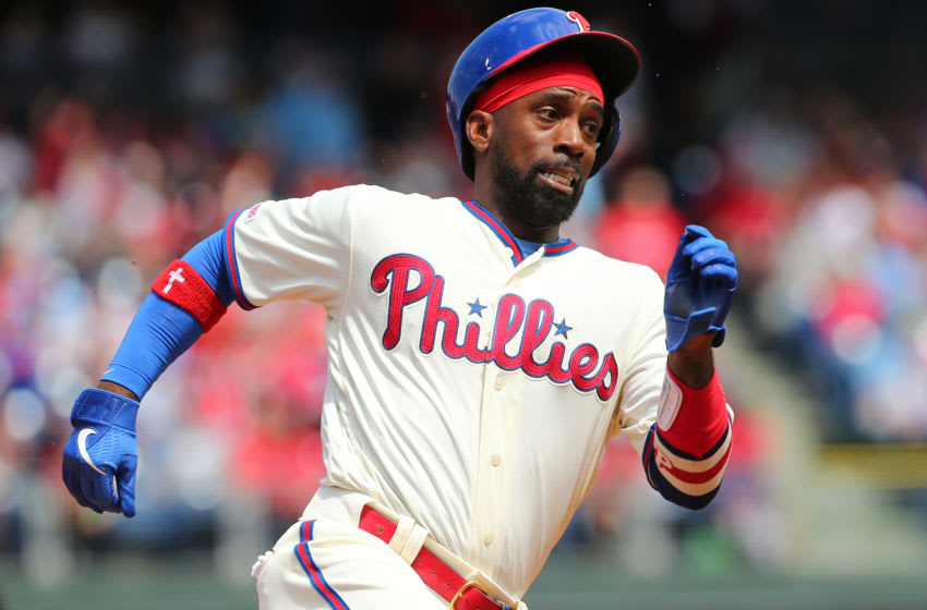 PHILADELPHIA, PA - APRIL 28: Andrew McCutchen #22 of the Philadelphia Phillies rounds third base as he scores on a triple by Jean Segura #2 against the Miami Marlins during the third inning of a game at Citizens Bank Park on April 28, 2019 in Philadelphia, Pennsylvania. (Photo by Rich Schultz/Getty Images)