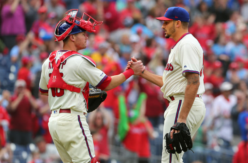 PHILADELPHIA, PA - APRIL 28: Pitcher Zach Eflin #56 of the Philadelphia Phillies is congratulated by catcher Andrew Knapp #15 after pitching a complete game 5-1 win over the Miami Marlins during a game at Citizens Bank Park on April 28, 2019 in Philadelphia, Pennsylvania. (Photo by Rich Schultz/Getty Images)
