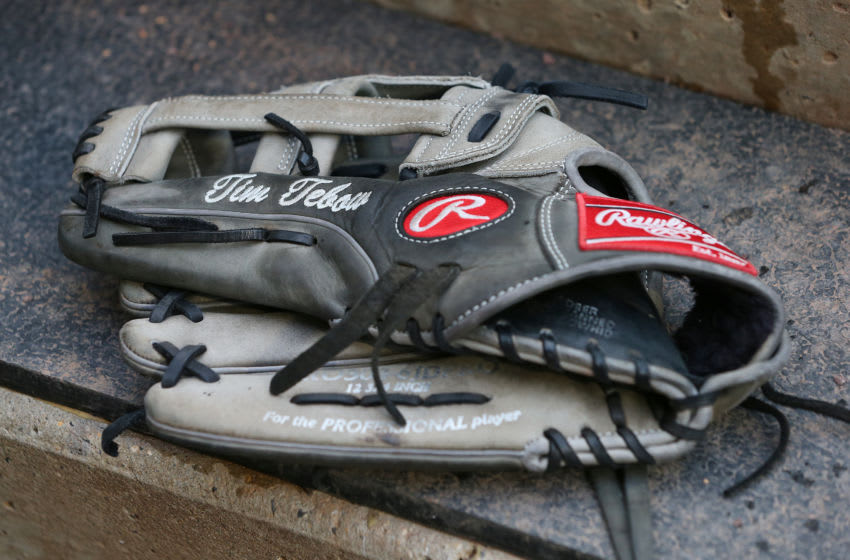ALLENTOWN, PA - APRIL 30: The Rawlings baseball glove of Tim Tebow #15 of the Syracuse Mets sits on the dugout step during a AAA minor league baseball game against the Lehigh Valley Iron Pigs on April 30, 2019 at Coca Cola Park in Allentown, Pennsylvania. (Photo by Rich Schultz/Getty Images)