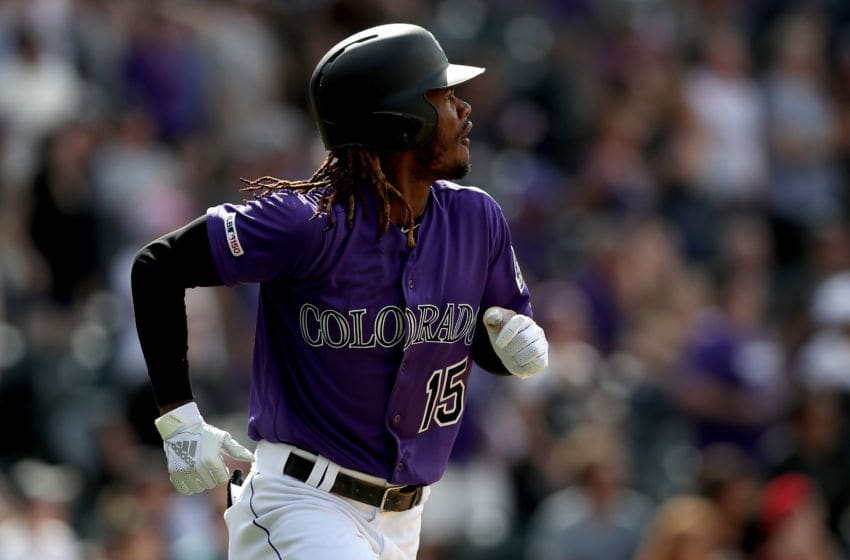 DENVER, COLORADO - MAY 05: Raimel Tapia the Colorado Rockies hits a 3 RBI triple in the eighth inning against the Arizona Diamondbacks at Coors Field on May 05, 2019 in Denver, Colorado. (Photo by Matthew Stockman/Getty Images)