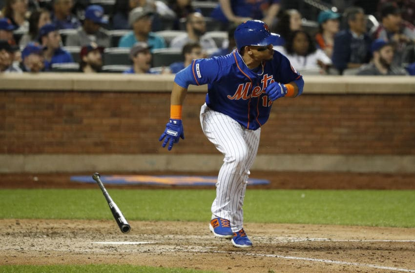 NEW YORK, NEW YORK - MAY 22: Juan Lagares #12 of the New York Mets runs to first base against the Washington Nationals during their game at Citi Field on May 22, 2019 in New York City. The New York Mets defeated the Washington Nationals, 6-1. (Photo by Michael Owens/Getty Images)