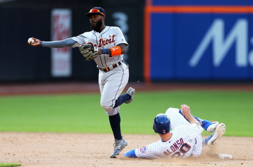 NEW YORK, NEW YORK - MAY 25: Pete Alonso #20 of the New York Mets is forced out as Josh Harrison #1 of the Detroit Tigers completes a double play in the eighth inning at Citi Field on May 25, 2019 in New York City. (Photo by Mike Stobe/Getty Images)