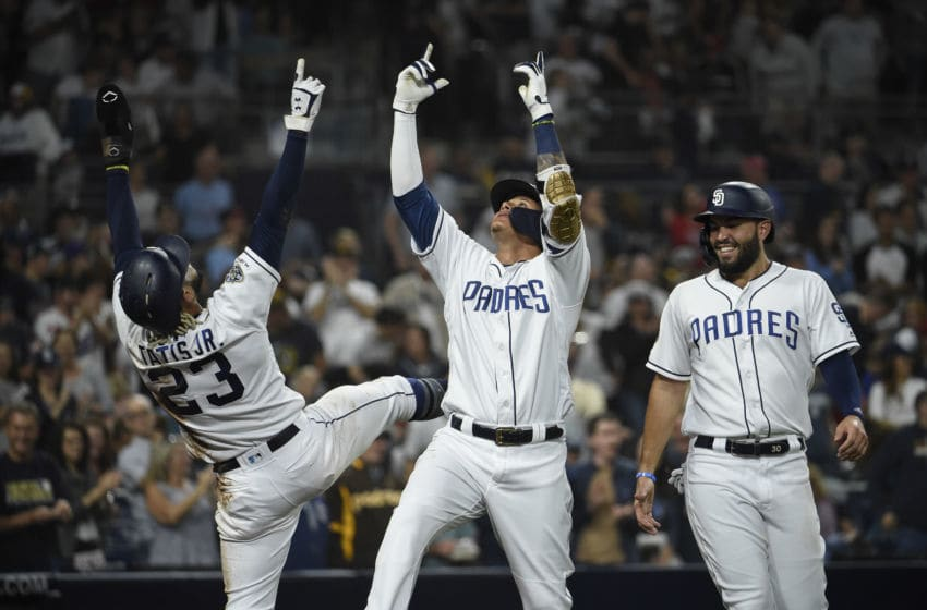 SAN DIEGO, CA - JUNE 29: Manny Machado #13 of the San Diego Padres, center, celebrates with Fernando Tatis Jr. #23, left, as Eric Hosmer #30 looks on after Machado hit a solo home run during the second inning of a baseball game against the St. Louis Cardinals at Petco Park June 29, 2019 in San Diego, California. (Photo by Denis Poroy/Getty Images)