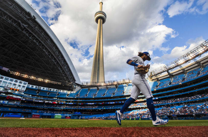 TORONTO, ONTARIO - AUGUST 9: Bo Bichette #11 of the Toronto Blue Jays runs on the field prior to the playing against the New York Yankees during their MLB game at the Rogers Centre on August 9, 2019 in Toronto, Canada. (Photo by Mark Blinch/Getty Images)