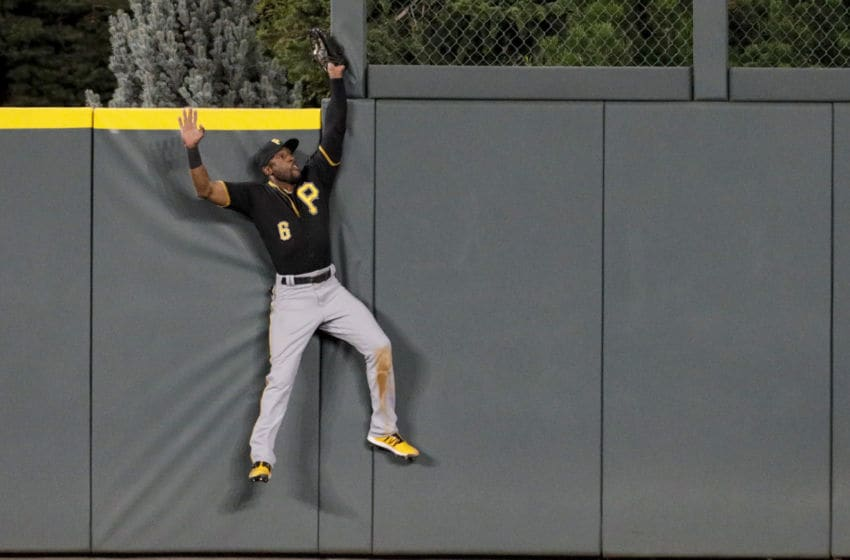 DENVER, CO - AUGUST 29: Starling Marte #6 of the Pittsburgh Pirates catches a fly ball off the bat of Nolan Arenado of the Colorado Rockies to end the fifth inning at Coors Field on August 29, 2019 in Denver, Colorado. (Photo by Joe Mahoney/Getty Images)