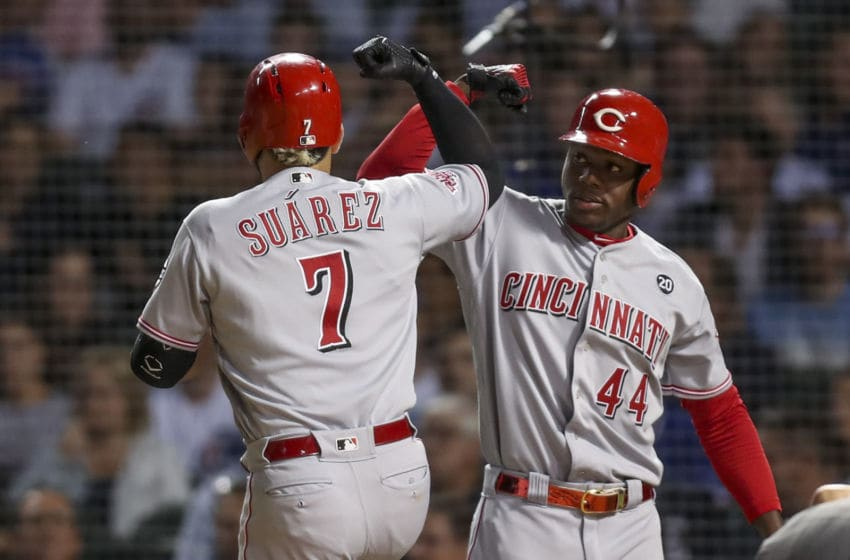 The Cincinnati Reds' Eugenio Suarez (7) celebrates with Aristides Aquino (44) after hitting a a solo home run during the fourth inning against the Chicago Cubs at Wrigley Field in Chicago on Wednesday Sept. 18, 2019. (Armando L. Sanchez/Chicago Tribune/Tribune News Service via Getty Images)