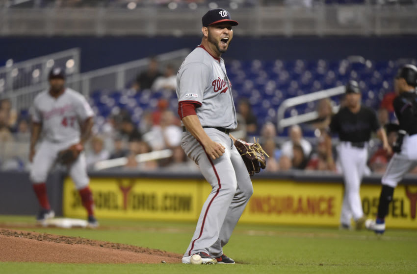 MIAMI, FL - SEPTEMBER 20: Anibal Sanchez #19 of the Washington Nationals reacts after dropping a ground ball off the bat of Isan Diaz #1 of the Miami Marlins during the second inning of the game at Marlins Park on September 20, 2019 in Miami, Florida. (Photo by Eric Espada/Getty Images)