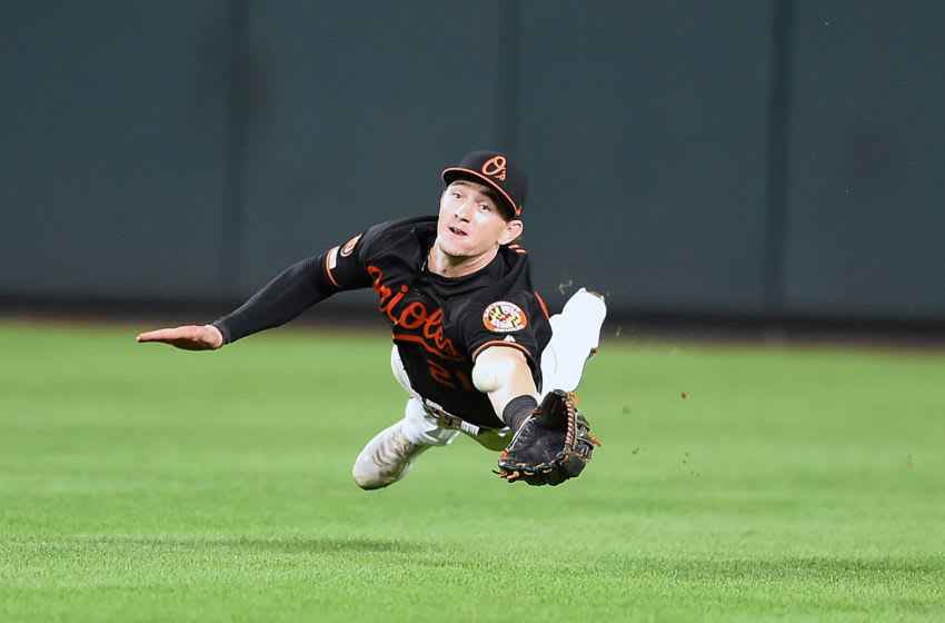BALTIMORE, MD - SEPTEMBER 20: Austin Hays #21 of the Baltimore Orioles makes a driving catch on a Omar Narvaez #22 (not pictured) of the Seattle Mariners fly ball in the ninth inning during a baseball game at Oriole park at Camden Yards on September 20, 2019 in Baltimore, Maryland. (Photo by Mitchell Layton/Getty Images)