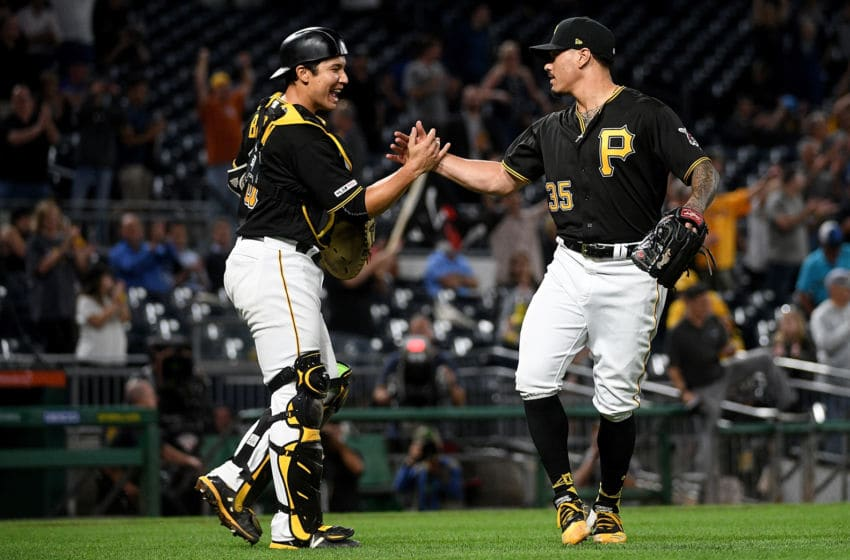 PITTSBURGH, PA - SEPTEMBER 25: Keone Kela #35 of the Pittsburgh Pirates celebrates with Steven Baron #61 after the final out in a 4-2 win over the Chicago Cubs at PNC Park on September 25, 2019 in Pittsburgh, Pennsylvania. (Photo by Justin Berl/Getty Images)