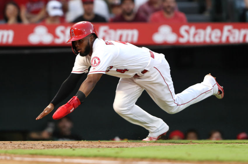 ANAHEIM, CALIFORNIA - AUGUST 31: Luis Rengifo #4 scores on an RBI single hit by Mike Trout #27 of the Los Angeles Angels of Anaheim during the second inning of a game against the Boston Red Sox at Angel Stadium of Anaheim on August 31, 2019 in Anaheim, California. (Photo by Sean M. Haffey/Getty Images)