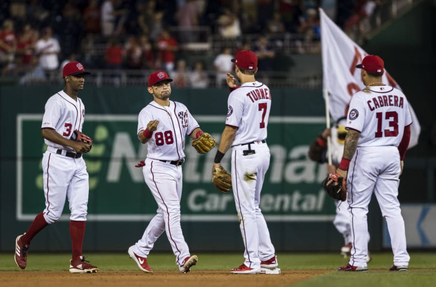 WASHINGTON, DC - SEPTEMBER 28: Gerardo Parra #88 of the Washington Nationals celebrates with Trea Turner #7 after the game against the Cleveland Indians at Nationals Park on September 28, 2019 in Washington, DC. (Photo by Scott Taetsch/Getty Images)