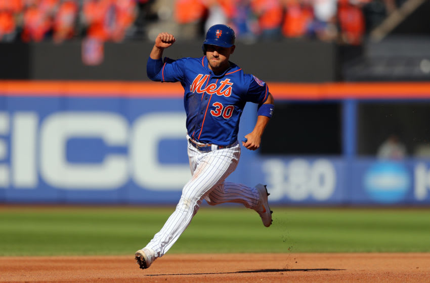 FLUSHING, NY - SEPTEMBER 29: Michael Conforto #30 of the New York Mets reacts to a home run by J.D. Davis #28 during the game between the Atlanta Braves and the New York Mets at Citi Field on Sunday, September 29, 2019 in Flushing, New York. (Photo by Alex Trautwig/MLB Photos via Getty Images)