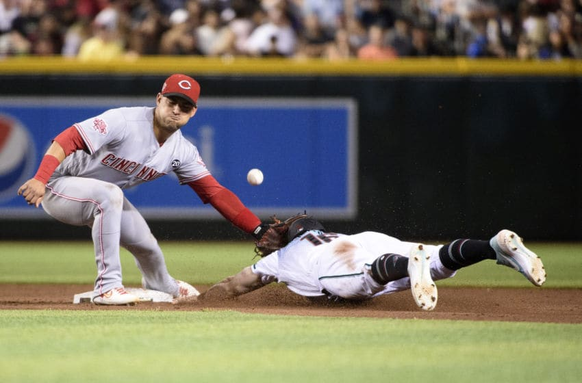 PHOENIX, ARIZONA - SEPTEMBER 13: Tim Locastro #16 of the Arizona Diamondbacks safely steals second base against Jose Iglesias #4 of the Cincinnati Reds during the sixth inning of the MLB game at Chase Field on September 13, 2019 in Phoenix, Arizona. (Photo by Jennifer Stewart/Getty Images)