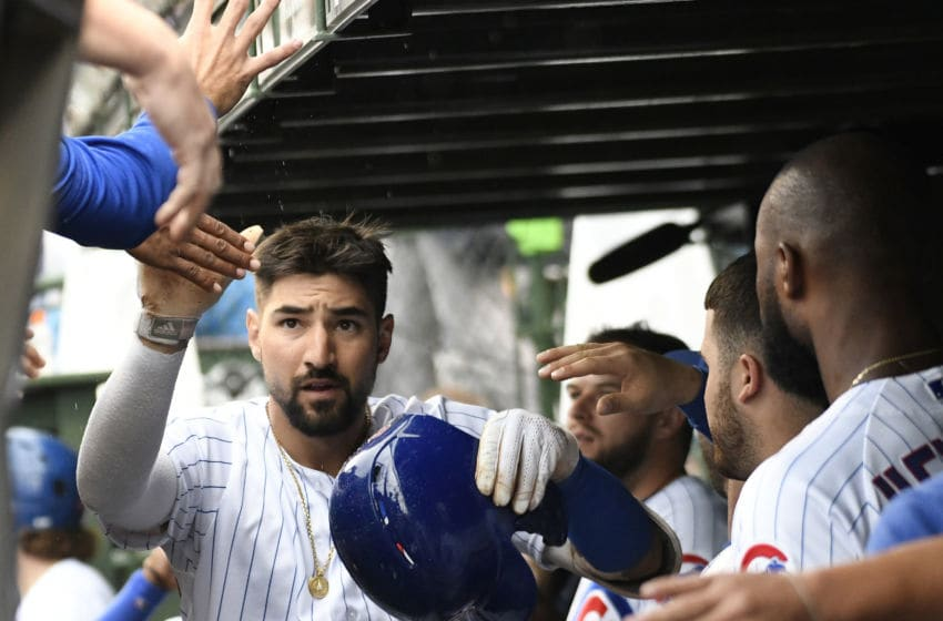 CHICAGO, ILLINOIS - SEPTEMBER 22: Nicholas Castellanos #6 of the Chicago Cubs is greeted in the dugout after hitting a home run against the St. Louis Cardinals during the sixth inning at Wrigley Field on September 22, 2019 in Chicago, Illinois. (Photo by David Banks/Getty Images)