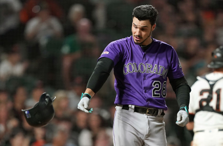 SAN FRANCISCO, CALIFORNIA - SEPTEMBER 25: Nolan Arenado #28 of the Colorado Rockies reacts and tosses his helmet away after striking out swinging against the San Francisco Giants in the top of the seventh inning at Oracle Park on September 25, 2019 in San Francisco, California. (Photo by Thearon W. Henderson/Getty Images)
