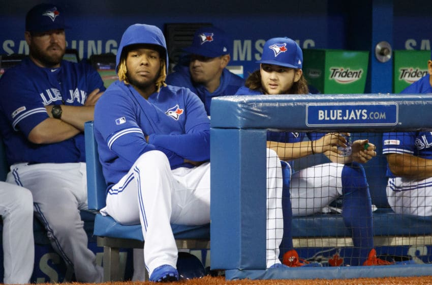 TORONTO, ON - SEPTEMBER 28: Vladimir Guerrero Jr. #27 and Bo Bichette #11 of the Toronto Blue Jays during the fourth inning of their MLB game against the Tampa Bay Rays at Rogers Centre on September 28, 2019 in Toronto, Canada. (Photo by Cole Burston/Getty Images)