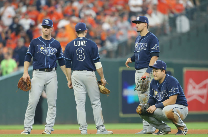 HOUSTON, TEXAS - OCTOBER 04: (L-R) Joey Wendle #18, Brandon Lowe #8, Willy Adames #1 and Ji-Man Choi #26 of the Tampa Bay Rays react against the Houston Astros during the fifth inning in game one of the American League Division Series at Minute Maid Park on October 04, 2019 in Houston, Texas. (Photo by Bob Levey/Getty Images)