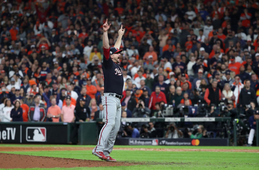 HOUSTON, TX - OCTOBER 30: Daniel Hudson #44 of the Washington Nationals celebrates after the Nationals defeated the Houston Astros in Game 7 to win the 2019 World Series at Minute Maid Park on Wednesday, October 30, 2019 in Houston, Texas. (Photo by Rob Tringali/MLB Photos via Getty Images)