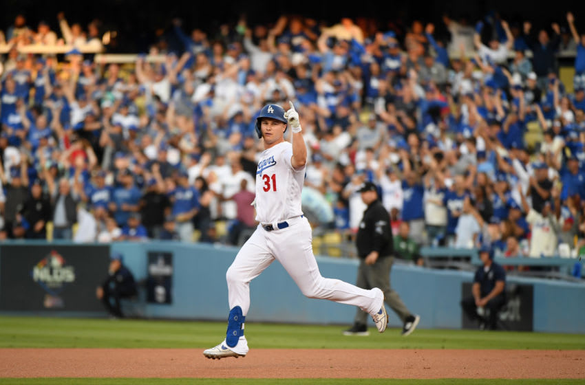 LOS ANGELES, CALIFORNIA - OCTOBER 09: Joc Pederson #31 of the Los Angeles Dodgers celebrates as he runs to second base on a ground rule double in the first inning of game five of the National League Division Series against the Washington Nationals at Dodger Stadium on October 09, 2019 in Los Angeles, California. (Photo by Harry How/Getty Images)
