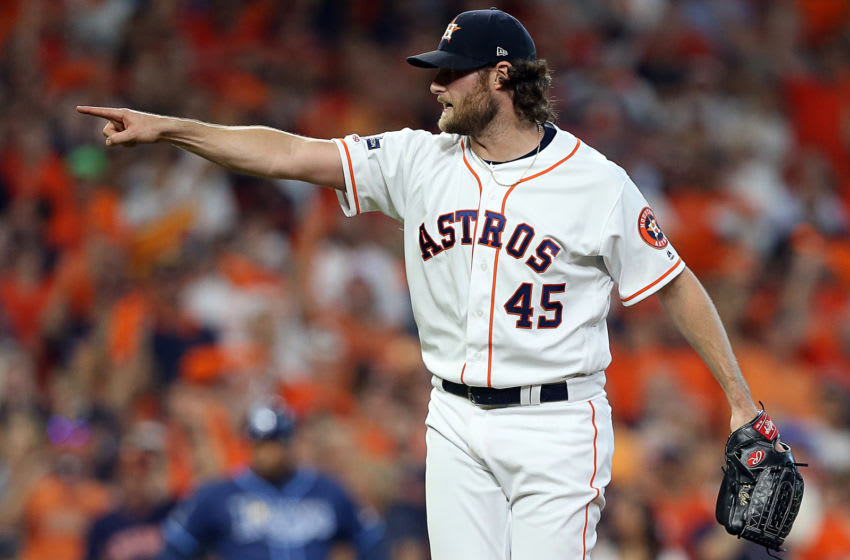 HOUSTON, TEXAS - OCTOBER 10: Gerrit Cole #45 of the Houston Astros pitches during Game 5 of the ALDS against the Tampa Bay Rays at Minute Maid Park on October 10, 2019 in Houston, Texas. Houston advances with a 6-1 win. (Photo by Bob Levey/Getty Images)