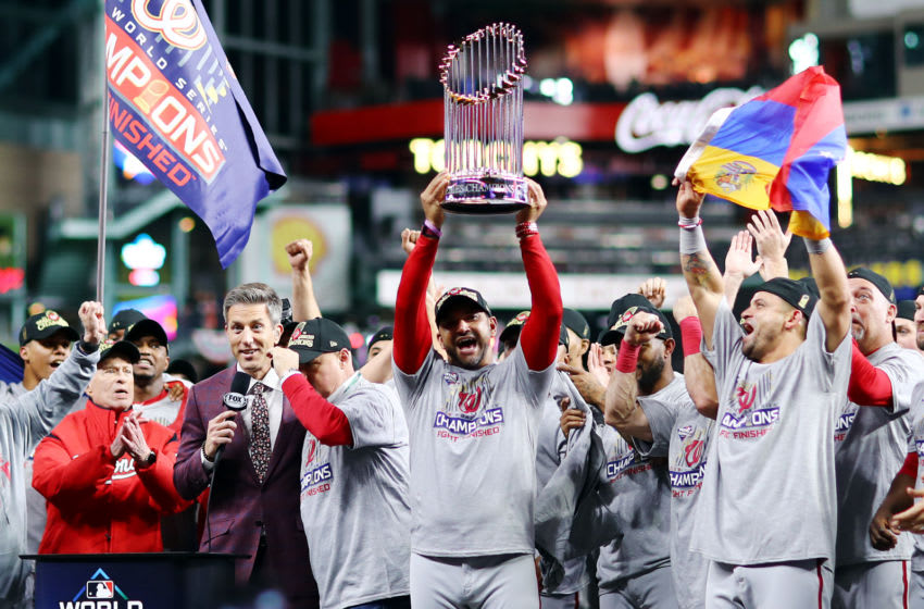 HOUSTON, TEXAS - OCTOBER 30: Manager Dave Martinez #4 of the Washington Nationals hoists the Commissioners Trophy after defeating the Houston Astros 6-2 in Game Seven to win the 2019 World Series in Game Seven of the 2019 World Series at Minute Maid Park on October 30, 2019 in Houston, Texas. (Photo by Mike Ehrmann/Getty Images)