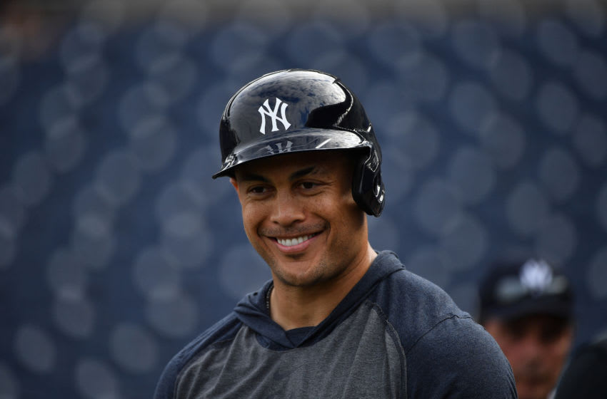 TAMPA, FLORIDA - FEBRUARY 24: Giancarlo Stanton #27 of the New York Yankees looks ons during batting practice before the spring training game against the Pittsburgh Pirates at Steinbrenner Field on February 24, 2020 in Tampa, Florida. (Photo by Mark Brown/Getty Images)